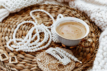 Cup Of Coffee With Rings, Earrings, Necklaces And Hair Clips