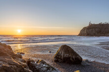 Sunset Along The Rugged Coast Of Washington On Ruby Beach In Olympic National Park.