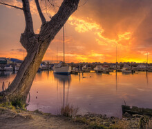 Boats Moored In A Harbour After A Storm At Sunset, Veneto, Italy