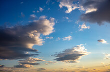 Sunrise, Sunset Few Clouds On Blue Sky Background. Copy Space.