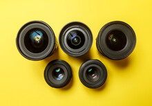 Photo Lenses In The Form Of The Logo Of The Olympic Rings On A Yellow Background