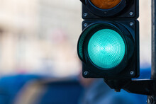 Close-up Of Traffic Semaphore With Green Light On Defocused City Street Background With Copy Space