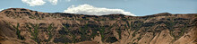 Yakima River Canyon Ridgeline Panoramic View On A Beautiful Summer Day With Blue Sky And Clouds.
