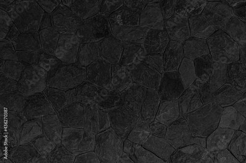 Fotografia Building exterior black granite block wall texture and background seamless