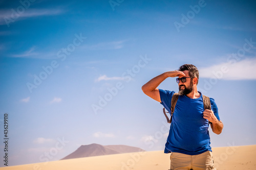 Adult man enjoy outdoor wild nature and adventure leisure activity alone walking Fototapeta