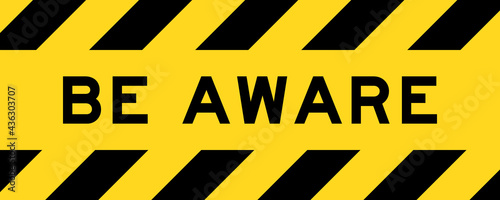 Fotografia Yellow and black color with line striped label banner with word be  aware