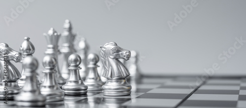 Obraz na plátne silver Chess figure team (King, Queen, Bishop, Knight, Rook and Pawn) on Chessboard against opponent during battle