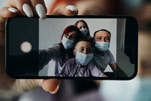 The Family Takes Pictures Of Themselves. Family Phone Close-up On Blurred Background. Coronovirus. Quarantine.