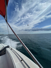 View Of The Sea And The Parachute Flying In The Sky From A Yacht