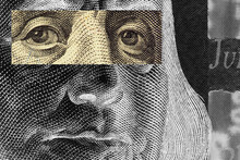 Franklin's Face Close-up With A Stripe Of Censorship On His Eyes On A 100 Dollar Bill. Unusual, Partially Black And White, Illustration.  American Economy And Public Debt. Macro