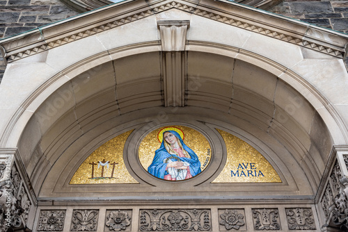 Fototapeta premium Virgin Mary at the entrance of the 'Our Lady of Sorrows' Church (1940) in Toronto, Canada