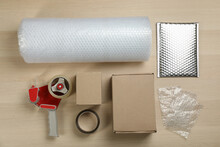 Flat Lay Composition With Bubble Wrap Roll On Wooden Background