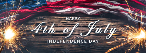 American Flag With Sparklers And Smoke On Wooden Background With Words