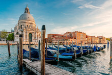 Gondolas And Santa Maria Della Salute Famous Church, Venice, Italy