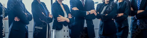 Fotografie, Obraz Many business people meeting standing in row with arms crossed and confident