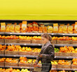 Woman buying fruits and vegetables at the market