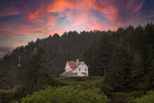 Historic Lighthouse Keepers House At Sunsetat Heceta Head Near Cape Perpetua On The Oregon Coast Near Floresnce.