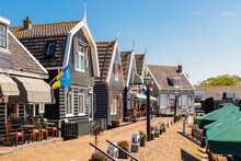Catering Establishments And Souvenir Shops In Traditional Wooden Houses At The Small Harbor In The Picturesque Fishing Village Of Marken.