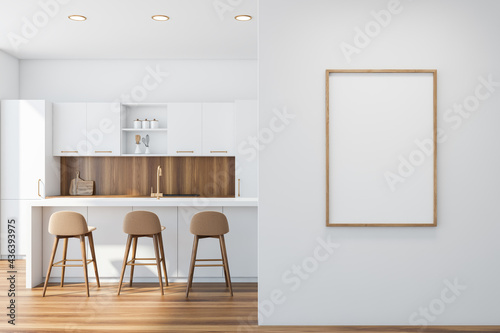 Poster in white and wooden kitchen interior with bar
