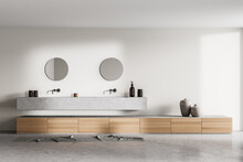 Bathroom Interior With Two Sinks And Mirrors With Concrete Floor
