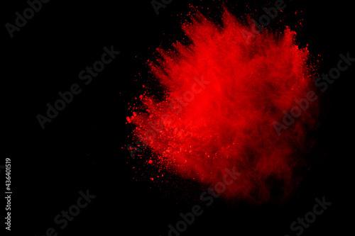 red powder explosion isolated on black background Fototapeta
