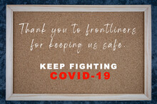 Thank You To Frontliners Message Written On Wooden Board. Covid-19