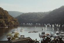 An Idyllic Scene Of Boats Sitting On The Calm Water At Berowra Waters, NSW.