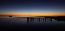 Early Sunrise With Jetty And Birds Over Calm Ocean At Monkey Mia, Western Australia