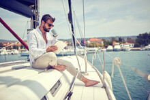 Relaxed Businessman Working On The Yacht