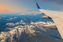 Flying Over Snow Capped Mountains, View Of Airplane Wing, Seattle