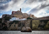 Fototapeta Nowy Jork - Cliffs and old area of Dalt Vila where the cathedral, the wall and the famous white houses are located, Ibiza in the Balearic Islands, Spain