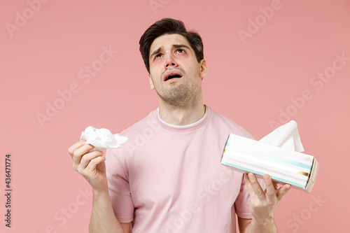 Canvas Print Sick unhealthy ill allergic man has red watery eyes runny stuffy sore nose suffe