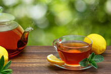 Hot Tea With Lemon And Mint In Glass Cup