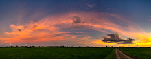 Panorama Beautiful Sunset With Dark Cloud Over Road And Rice Field In Thailand.blue Sky With Clouds.Fiery Orange Sunset Sky. Beautiful Sky.Sunrise With Cloud Over Rice Field.