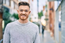Young Caucasian Man Smiling Happy Standing At The City.
