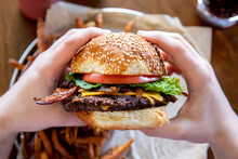 Person Holding Cheese Burger