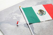 Leinwandbild Motiv World map with pin and Mexican flag on light background, closeup