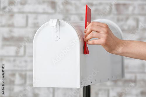 Obraz na plátně Woman with mail box on brick background