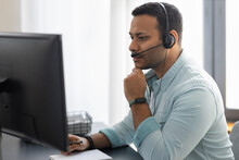 Portrait Of Focused Employee Support Services. Serious Man In Headset With Microphone Working In Office, Video Conference Or Video Call