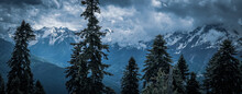 Mountain Landscape With Trees And Dramatic Clouds