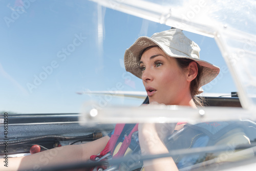 woman in glider with excited expression Fototapeta