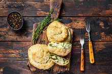 Baked Spiral Filo Pastry Puff With Feta Cheese And Spinach. Dark Wooden Background. Top View