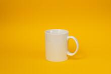 White Mug On Yellow Background