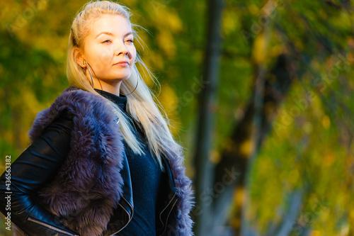 Fotografija Fashion woman walking in autumn park