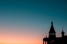 Church With Domes Silhouette, On A Sunset Background With Free Space For Text (copy Space).