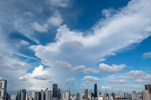 Clouds And Blue Sky Over The Thong Lo District In Downtown Bangkok, Thailand