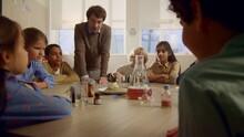 Children Studying Chemistry At Table. Teacher Doing Pharaoh Snake Experiment
