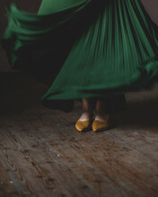 Low Section Of Woman With Green Twirling Skirt