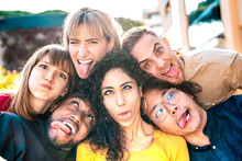 Multiethnic Milenial People Taking Selfie Sticking Out Tongue With Happy Faces - Funny Life Style And Integration Concept With Interracial Young Friends Having Fun Together