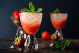 Fresh cocktail with crushed ice, strawberry and mint